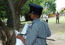 Photo: A police officer seen while going about taking away placards from individuals at Independence Square on Monday 2nd August 2021 (social media image)